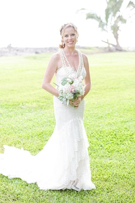 bride in essence of australia gown, hawaiian ceremony lei