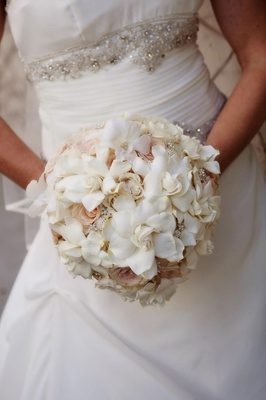 Round bouquet of gardenias, orchids, and roses