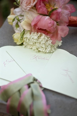 Pink and green stationery fans for wedding ceremony