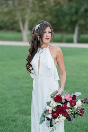 bride in bhldn wedding reception dress with alfred angelo headpiece