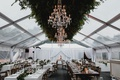 wedding reception greenery chandelier long table wood low centerpiece white drapery king's tables