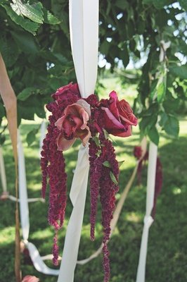 Orchids and amaranthus tied to ribbons