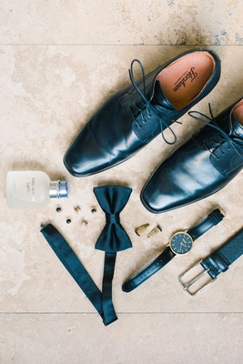 groom accessories, black dress shoes, black leather belt, black watch, bow tie, cufflinks, cologne