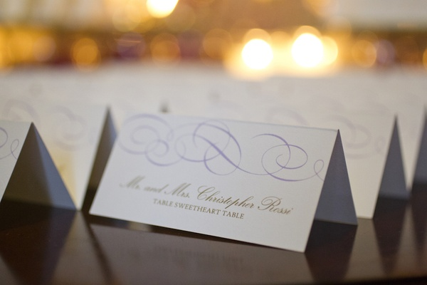 Wedding escort cards with a light purple wavy pattern