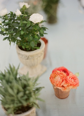 Green, white, and orange floral centerpieces