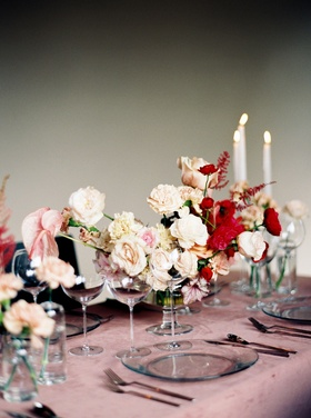 Wedding reception pink velvet linen tablecloth pink and red flowers taper candles candlelight