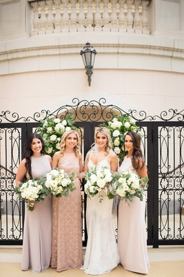 bride in alon livne dress, bridesmaids in mismatched dresses in faint pale hues