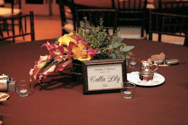 framed calla lily table sign and floral centerpiece