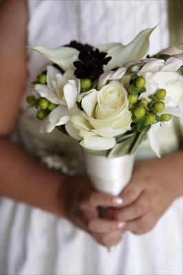 Flower girl holding small nosegay of flowers