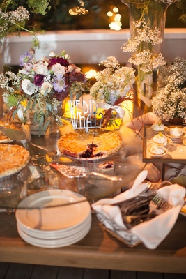 Multi-tiered display of desserts and pies