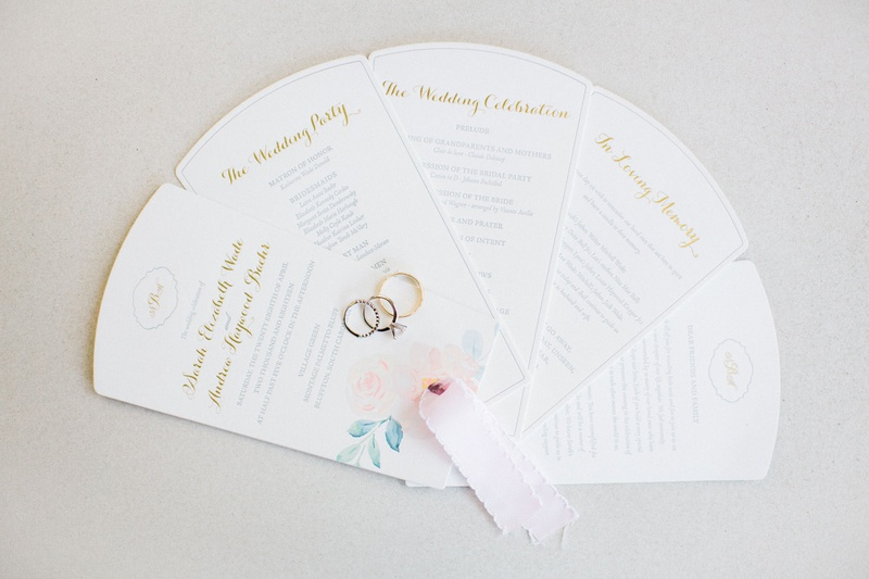 wedding ceremony program fan multiple page style wedding rings on top light pink ribbon pastel