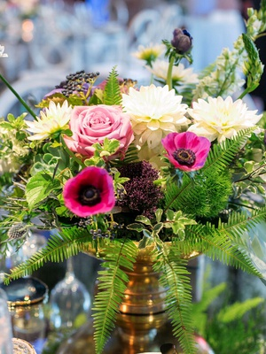 small arrangement of flowers including pink anemones, roses, white dahlias, ferns