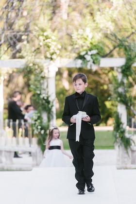 cheryl burke and matthew lawrence wedding ceremony ring bearer in black tuxedo and black shirt