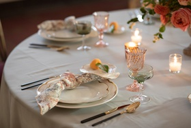 softly patterned napkin tied in a knot at the place settings, wedding styled shoot