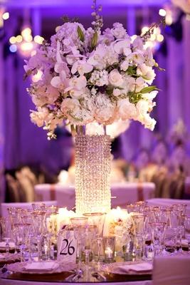 Purple wedding reception with crystal centerpiece