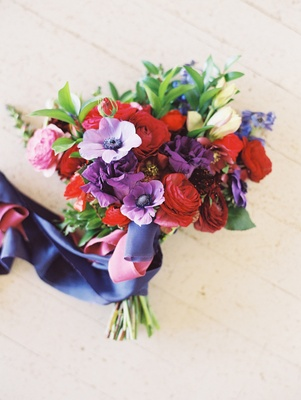 boho-chic bouquet, purple, red, and pink flowers, navy ribbon,