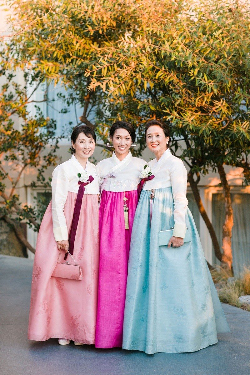 bride with female family members mother in traditional korean wedding attire hanbok in pink and blue