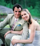 Man in khaki suit and woman in strapless bridal gown
