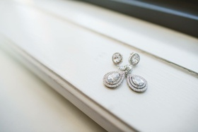 double halo teardrop earrings with diamond on ear halo design