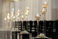 Crystal, white, and black ceremony decor