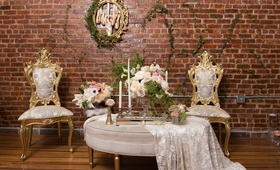 wood floors, vines on brick wall, vintage-inspired chairs