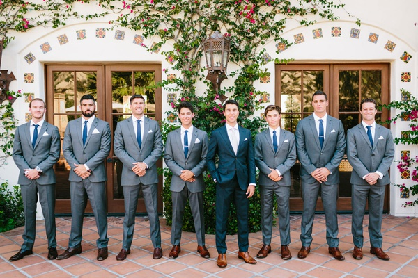 wedding portrait groom and groomsmen in grey suits with navy blue ties brown dress shoes spanish