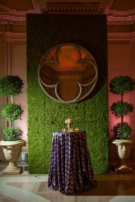 Manicured topiaries and green grass wall with mirror