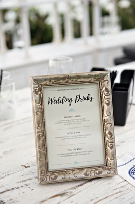 Wedding drinks menu on whitewash wood bar with antique frame casamigos tequila bar menu ideas