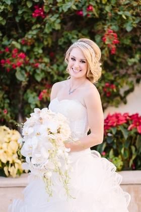 Demetrios wedding dress strapless ball gown ruffles orchid bouquet roses