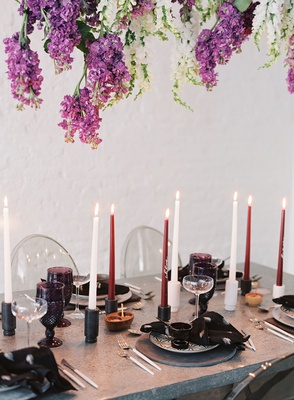wisteria flowers metal silver table tall taper candle purple colored glassware modern tablescape