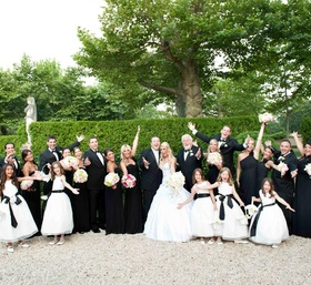 Bride and groom with bridal party in the gardens of Oheka Castle