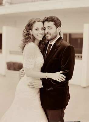 Sepia photo of beaded wedding dress and black suit
