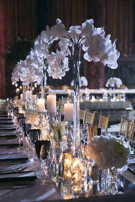 Wedding reception table with mirror runner, white orchids, calla lilies, candles at Cipriani Wall St