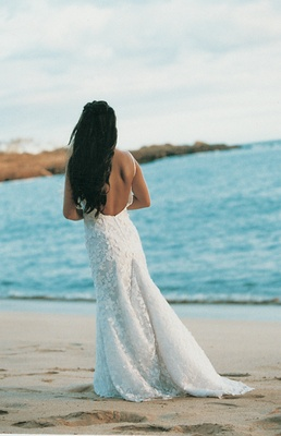 rear view of wedding dress with lace skirt and low back