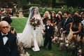 Stephanie Perez with son at wedding holding hands fall bouquet outdoor ceremony