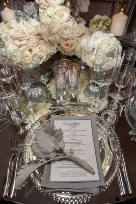 wedding reception place setting mirror table silver beaded charger plate grey napkin feather decor