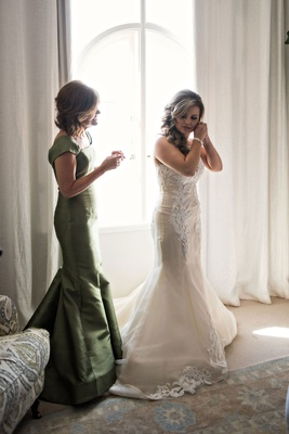 Mother of bride in olive green gown cap sleeve mermaid style curled hair bridal suite