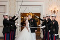 Bride and groom kiss in tunnel of swords US Marine Corps