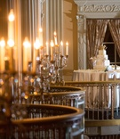 White wedding cake on a ballroom balcony of the Millennium Biltmore Hotel Los Angeles