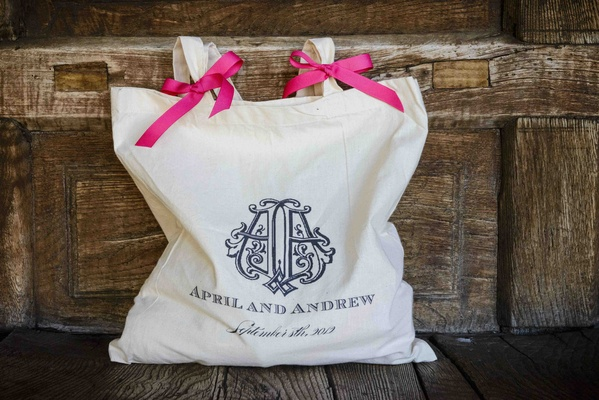 Wedding welcome bag with pink ribbons and monogram
