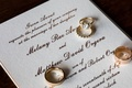Rose gold gold wedding band wedding rings on calligraphy invitation