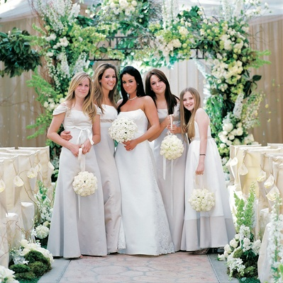 Bride with females wearing long off-white dresses