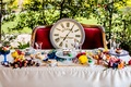 alice in wonderland inspired wedding styled shoot, clock on velvet couch, sweetheart table