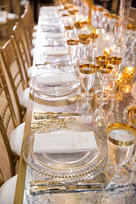 Wedding reception long table mirror gold base gold chairs glassware charger beaded