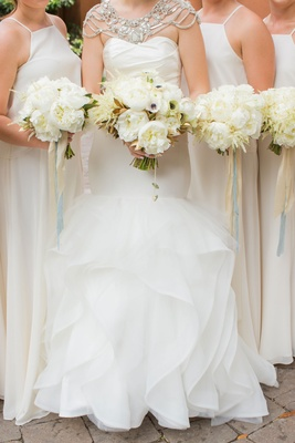 Bride in Hayley Paige mermaid gown with bridesmaids in white ivory bouquets peony flowers