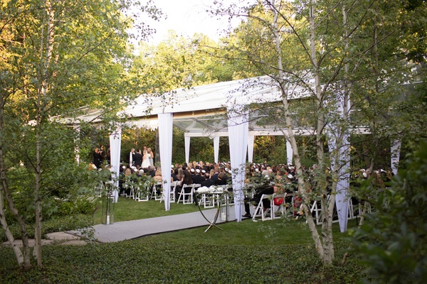 White clear top wedding tent in backyard Illinois outdoor wedding ceremony
