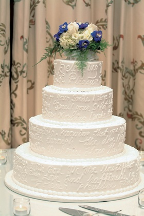 Four layer cake with inscription and flowers