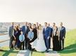 bride in one shoulder mira zwillinger wedding dress groom in blue suit with family mykonos wedding