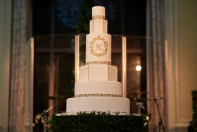 six tier wedding cake with gold detail, round and geometric tiers