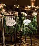 bride and groom sign with fern garlands tied with tulips